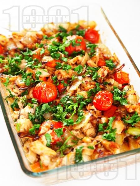 Печена бяла риба със зеленчуци в бира на фурна - снимка на рецептата